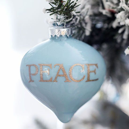 A hand-painted glass ornament captures everything that is beautiful about the se...