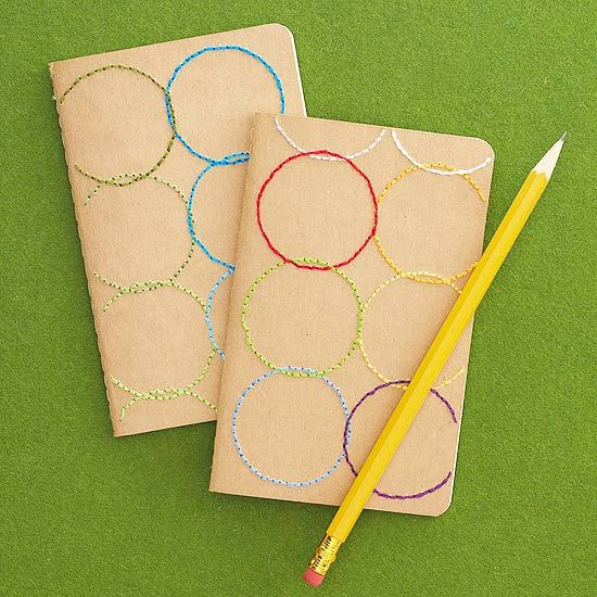 Brighten a plain notebook or journal with colorful embroidery floss for a though...