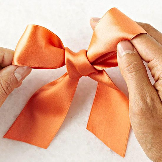 Finally! Learn how to tie the perfect bow to adorn your wrapped presents, wreath...