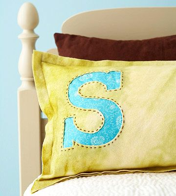 These monogrammed, wool felt pillows can go home with house guests after their h...