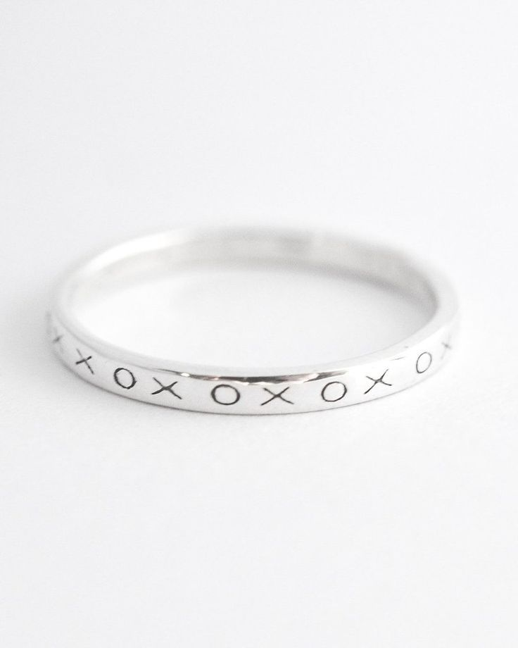 This XOXO stacking ring look great on their own or in a stack. Pair this hugs an...