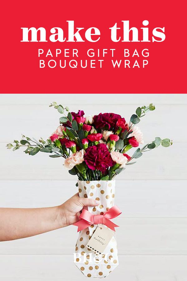 Instead of wrapping a present, use a paper gift bag to wrap a gorgeous bouquet o...